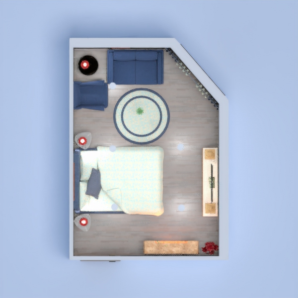 A small bedroom with sitting area